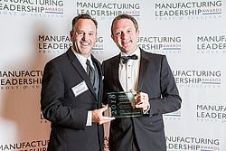 Ulrich Ermel and Chris Harman accepted the Manufacturing Leadership Award 2018 for PULS. (Source: Frost & Sullivan)